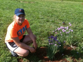 Brodde transplanting a chive plant!