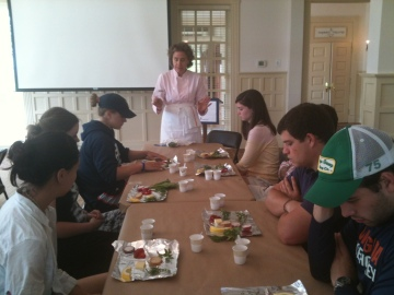Martha telling students about the benefits of toasting (pine nuts, walnuts, almonds...you name it!)
