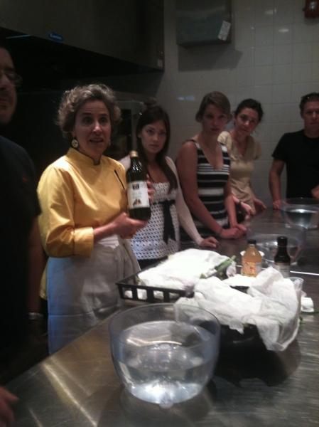 Making a salad dressing using olive oil, apple cider vinegar, and tamari sauce.